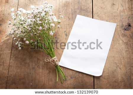 bouquet of baby's breath (or Gypsophila), with blank memo paper by a natural sunlight window.