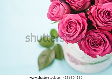 Bouquet of beautiful pink roses on light blue background