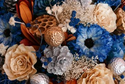 bouquet of blooming artificial blue, silver and orange flower