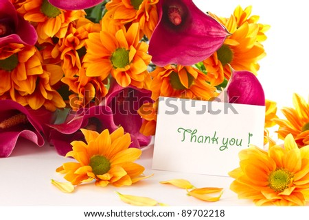 bouquet of calla lilies and orange chrysanthemums on white background