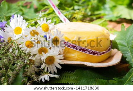 bouquet of daisies and cheese with fern and ribbon. symbolism of Latvia for Ligo holiday #1411718630