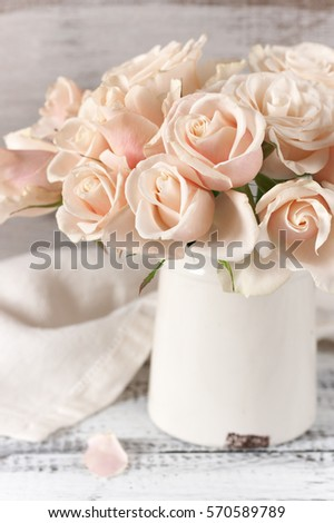 Bouquet Of Delicate Pink Roses In Vintage Tin Vase On Rough Rustic