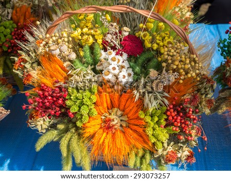 bouquet of dried flowers and colorful cereals on an occasion of the end of harvesting