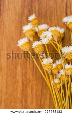 Bouquet of dried flowers on wooden background.