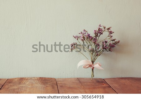 bouquet of dried flowers rope against wooden background