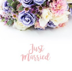 Bouquet of dried wild flowers on white table background view horizontal, empty space for publicity information , just married or advertising text