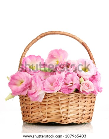 bouquet of eustoma flowers in basket, isolated on white
