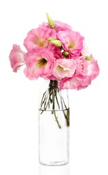 bouquet of eustoma flowers in bottle, isolated on white