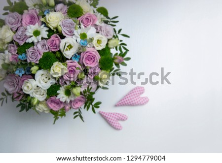 Bouquet of flovers and two hearts on white background. St Valentine's day consept #1294779004