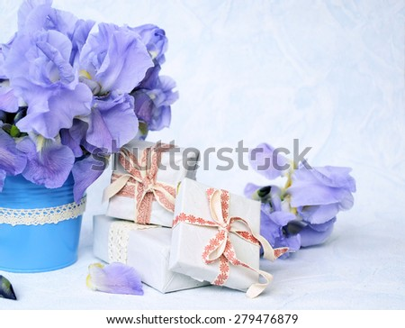 bouquet of flowers and a gift, background for text