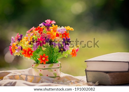 bouquet of flowers and book in nature background
