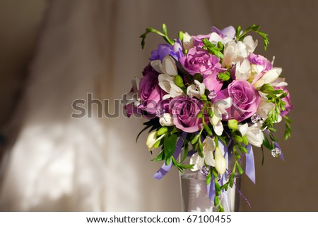 bouquet of flowers and wedding dress