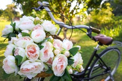 Bouquet of flowers in a bicycle basket.