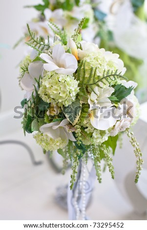 bouquet of flowers in a vase in a luxurious interior