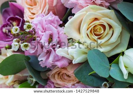bouquet of flowers in gentle tones close up #1427529848