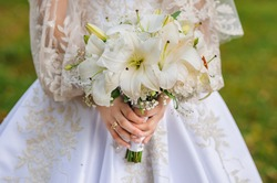 Bouquet of flowers in the hand of the bride