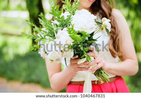 Bouquet of flowers of a girl #1040467831