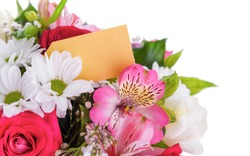 Bouquet of flowers with a greeting card. Place to place your text.