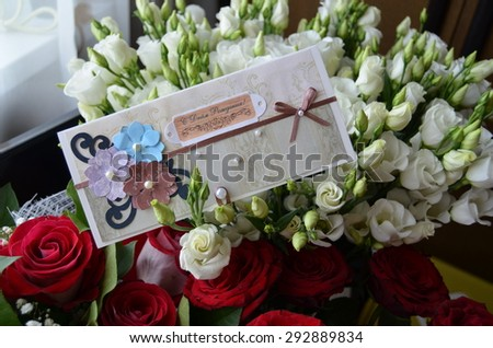 Bouquet of flowers with birthday greeting card\ Translation from russian: happy Birthday!