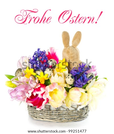 bouquet of fresh spring tulip, narcissus and hyacinth flowers with easter bunny on white background. Frohe Ostern! german card concept