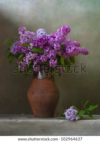 Bouquet of lilacs in a brown jug