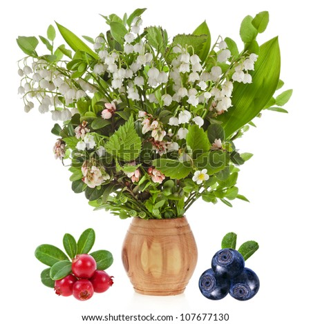 bouquet of lilies-of-the-valle  with blueberries , cowberries Isolated on white background