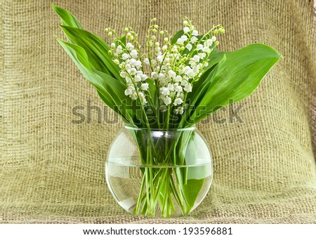 Bouquet of lily of the valley in a round vase