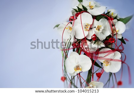 bouquet of orchid and wedding dress