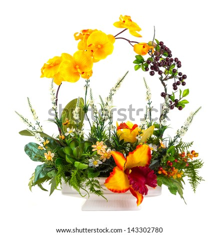Bouquet of orchid, berry and fern in ceramic pot isolated on white
