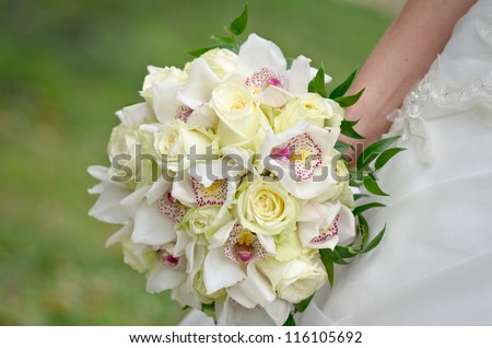 Bouquet of orchid flowers and roses