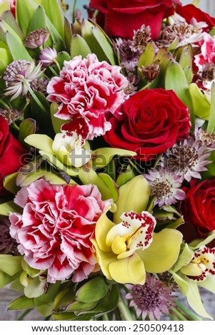 Bouquet of orchid, rose and carnation flowers