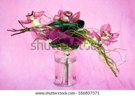 bouquet of orchids in the background