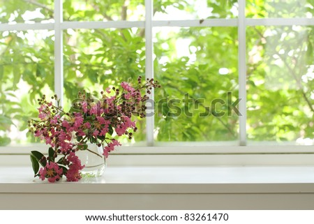bouquet of pink flowers on a window