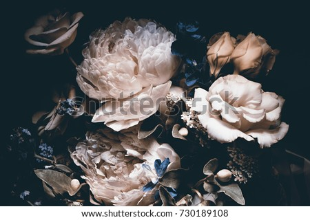 Photo of bouquet of pink peonies, dark background,