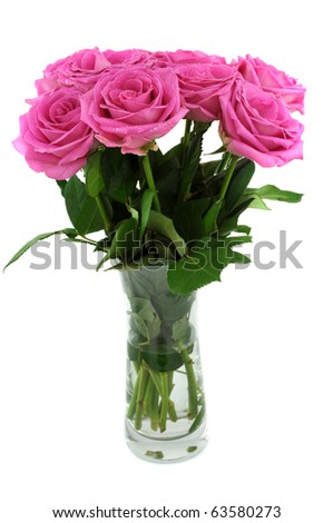 Bouquet of pink roses in a vase, isolated on white