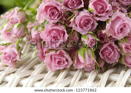 bouquet of pink roses on bamboo mat