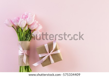 Bouquet of pink tulips on a pink background. Stock fotó ©