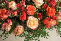 Bouquet of red, orange, yellow roses- a composition of multi-colored roses. Background for a postcard.