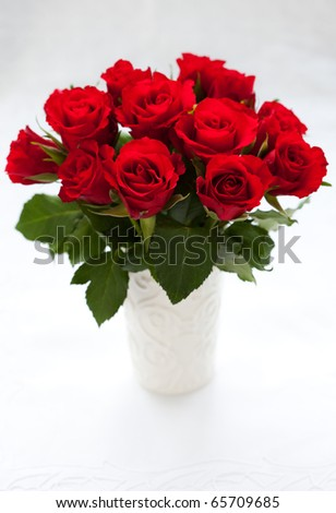 bouquet of red roses in vase on the white background