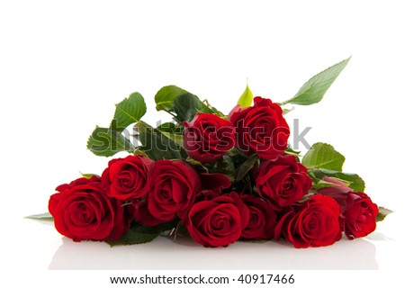 Bouquet of red roses isolated over white - stock photo