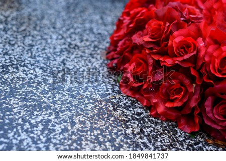 Bouquet of red roses laying on marble tombstone.  Photo stock ©