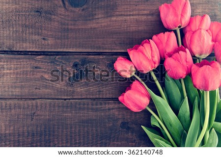Bouquet of red tulips on a wooden background. Spring flowers. Mother\'s Day background.