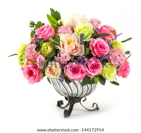 Bouquet of roses hydrangea and orchid in glass vase isolated on white