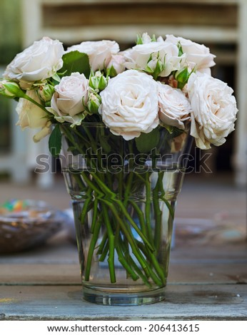 bouquet of roses in a vase with water