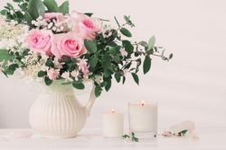 bouquet of roses with candles