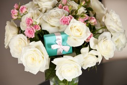 Bouquet of roses with present
