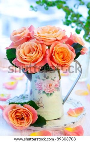 Bouquet of salmon-pink roses  in a jug