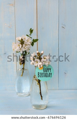 bouquet of spring cherry  flowers with happy birthday card