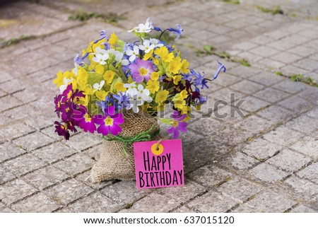 bouquet of spring flowers  with happy birthday card
