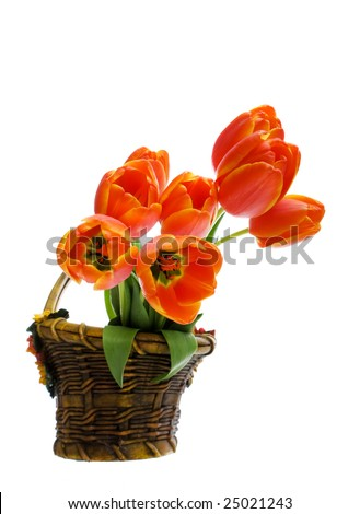 bouquet of tulips in a ceramic flower basket